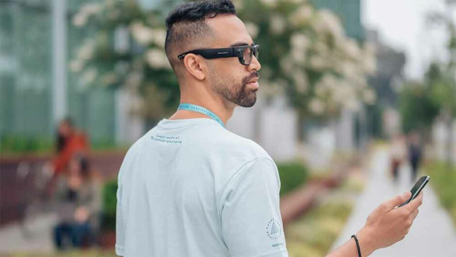 A man wearing Facebook Aria prototype glasses